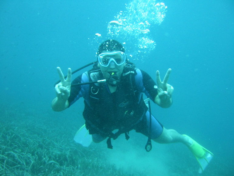 scuba diver happy underwater